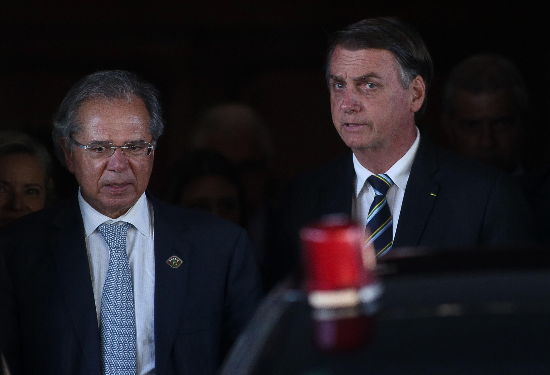 O presidente Jair Bolsonaro e o ministro da Economia, Paulo Guedes, após reunião na sede do ministério, em Brasília no dia 6 de maio de 2019.