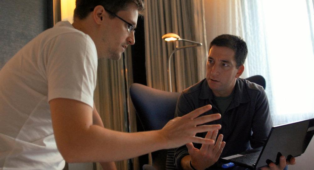 Denunciante-no exílio Edward Snowden e jornalista Glenn Greenwald