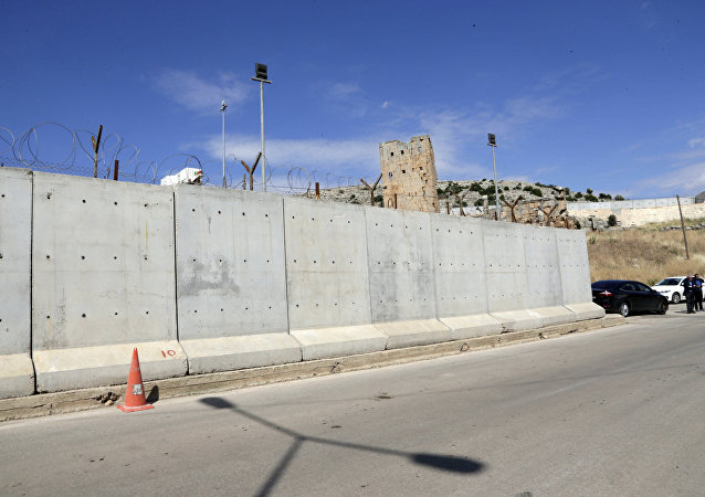 This May 24, 2017 file photo shows the newly built wall near Cilvegozu border gate in Reyhanli, at the Turkey-Syria border