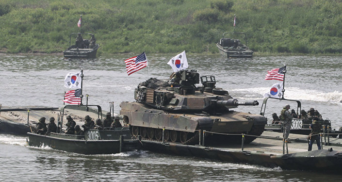 A U.S. Army M1A2 tank crosses Nam Han river on a South Korean military barge during a joint military exercise between the U.S. and South Korea in Yeoncheon near the border with North Korea, in South Korea, Thursday, May 30, 2013