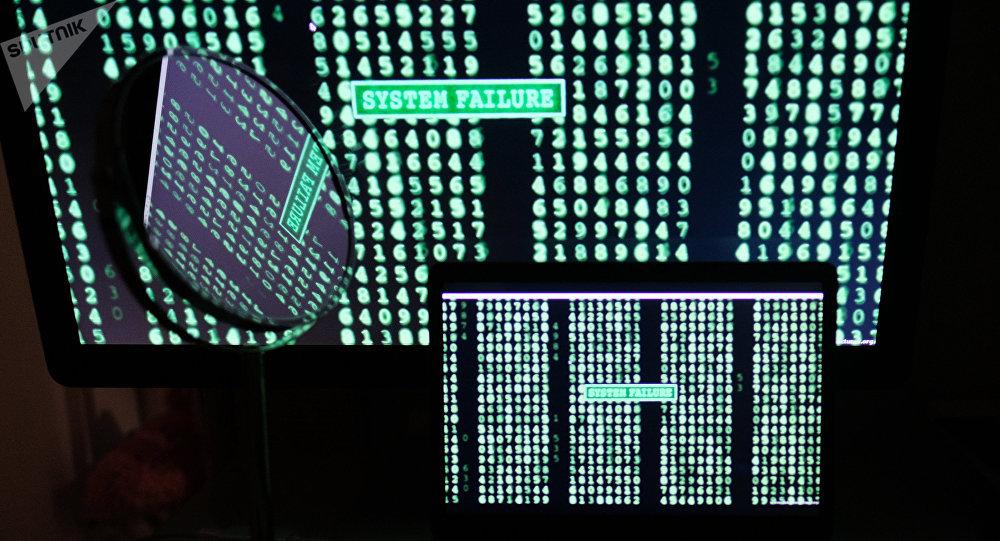 Linhas de código nas telas de computadores.