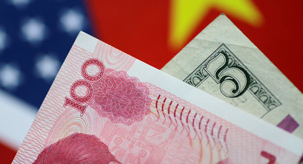 U.S. Dollar and China Yuan notes are seen in this picture illustration June 2, 2017