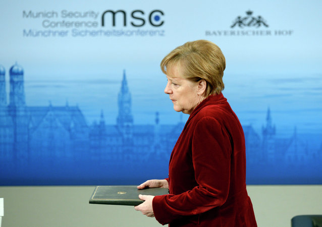 German Chancellor Angela Merkel enters the podium to deliver a speech during the 51st Munich Security Conference (MSC) in Munich