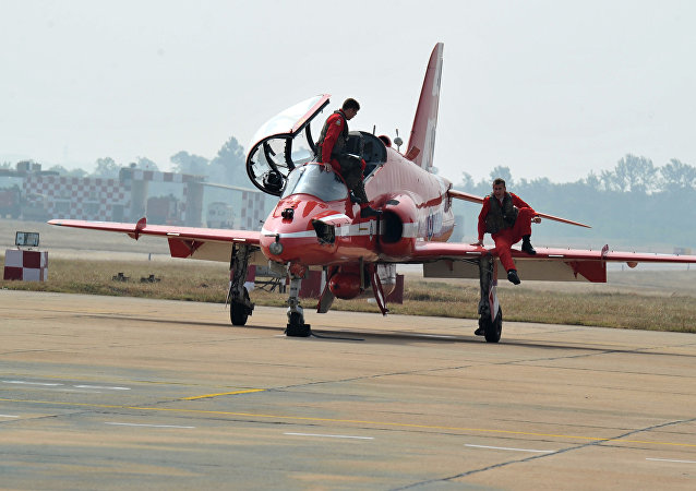 (File) Members of the British Royal Air Force (RAF) aerobatic team, the 'Red Arrows' leave the aircraft after performing manoeuvres at the Indian Air Force Academy, Dundigal on the outskirts of Hyderabad on November 17, 2016
