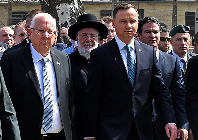 Poland's President Andrzej Duda (R) and Israel's President Reuven Rivlin (L) attend the March of the Living, a yearly Holocaust remembrance march between the former death camps of Auschwitz and Birkenau, in Oswiecim