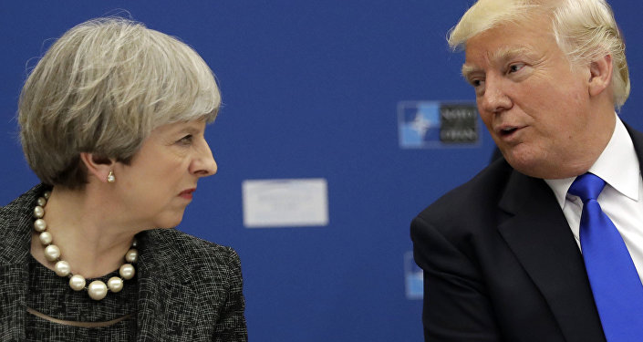 US President Donald Trump, right, speaks to British Prime Minister Theresa May during in a working dinner meeting at the NATO headquarters during a NATO summit of heads of state and government in Brussels on Thursday, May 25, 2017.