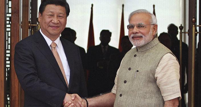 Xi Jinping, presidente da China, e Narendra Modi, primeiro-ministro da Ìndia, durante encontro bilateral na cidade cidade chinesa de Wuhan.