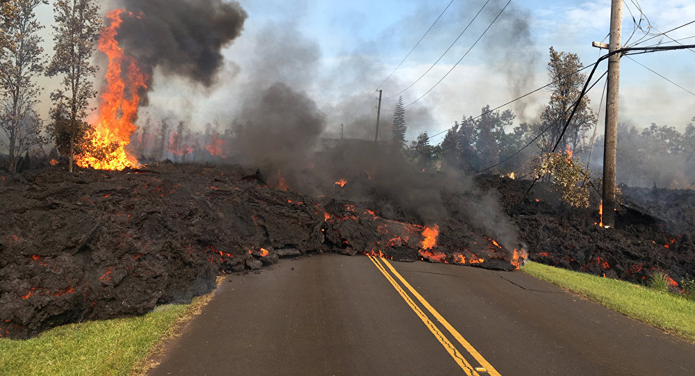 Lava advances along a street near a fissure in Leilani Estates, on Kilauea Volcano's lower East Rift Zone, Hawaii, the U.S., May 5, 2018