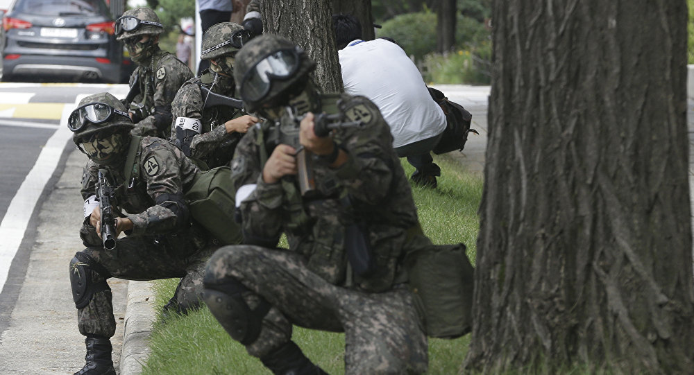South Korean army soldiers conduct an anti-terror drill as part of Ulchi Freedom Guardian exercise, at the National Assembly in Seoul, South Korea