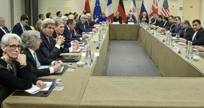 US Under Secretary for Political Affairs Wendy Sherman (L), US Secretary of Energy Ernest Moniz (2nd L) and US Secretary of State John Kerry (3rd L) wait to start a meeting with P5+1, European Union and Iranian officials as part of talks on Iran's nuclear program at the Beau Rivage Palace Hotel in Lausanne.