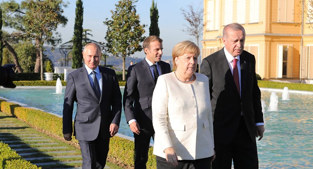 Russian President Vladimir Putin, French President Emmanuel Macron, German Chancellor Angela Merkel and Turkish President Recep Tayyip Erdogan (right) during the meeting on Syria, October 27, 2018.