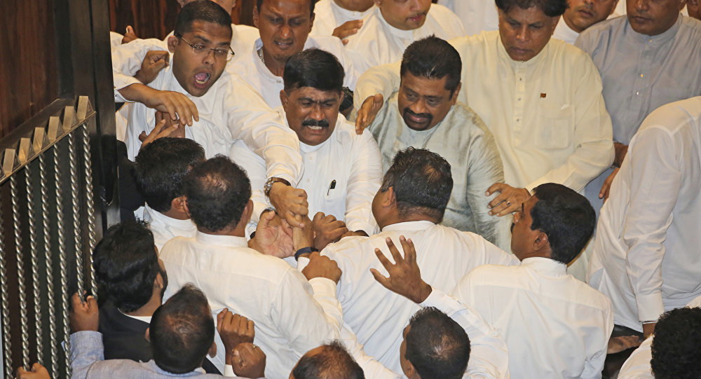 Sri Lankan Lawmakers fight in the parliament chamber in Colombo, Sri Lanka, Thursday, Nov. 15, 2018