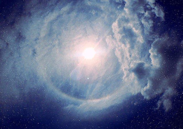 Estrela rodeada por nuvem de poeira (imagem ilustrativa)