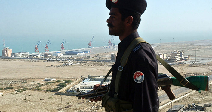 A Pakistan security personnel stands guard near the the Beijing-funded megaport of Gwadar, in southwestern Pakistan