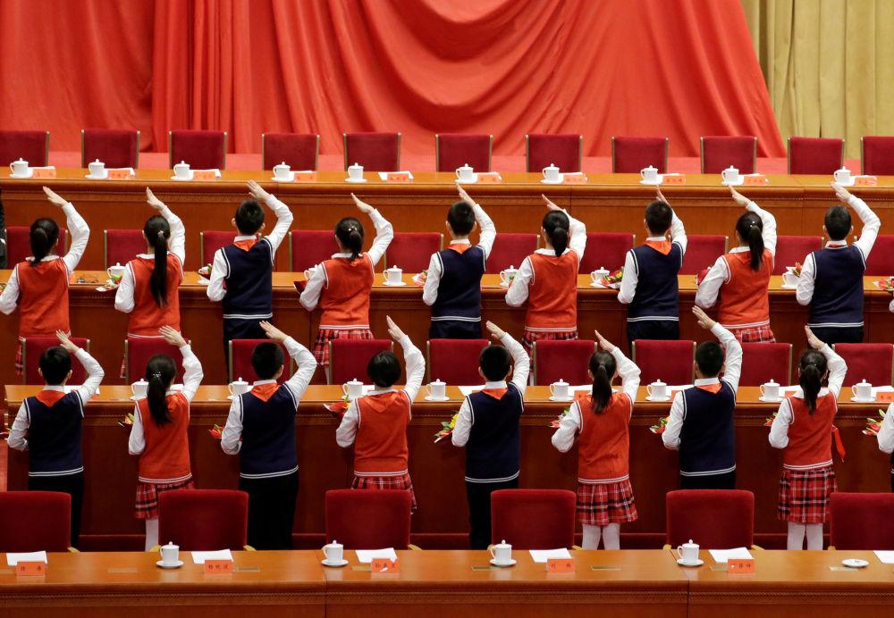 Estudantes durante evento que marca o 40º aniversário da reforma e abertura da China no Grande Salão do Povo, em Pequim, 18 de dezembro de 2018