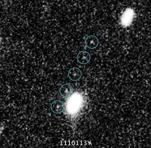 Imagens tiradas pelo telescópio Hubble do objeto Ultima Thule (2014 MU69) do Cinturão de Kuiper, em 24 de junho de 2014