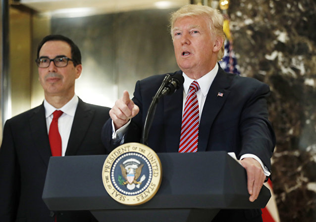 President Donald Trump, accompanied by Treasury Secretary Steven Mnuchin, speaks to the media in the lobby of Trump Tower in New York, Tuesday, Aug. 15, 2017