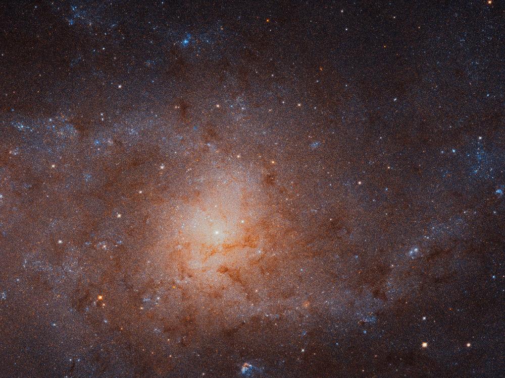 O telescópio espacial Hubble consegue tirar uma foto detalhada da galáxia do Triângulo, a vizinha mais próxima da Via Láctea