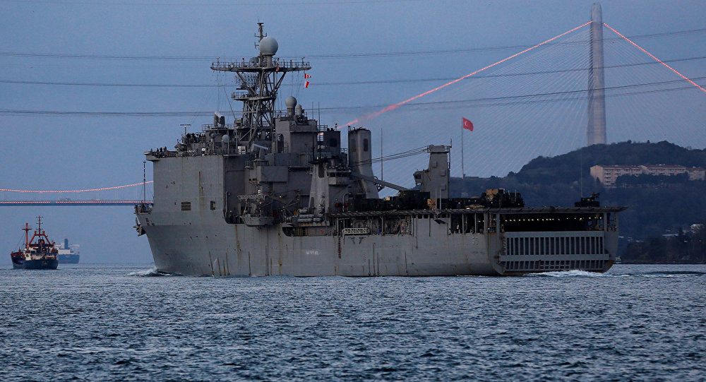 USS Carter Hall, a dock landing ship of the United States Navy, sets sail in the Bosphorus, on its way to the Black Sea, in Istanbul, Turkey,