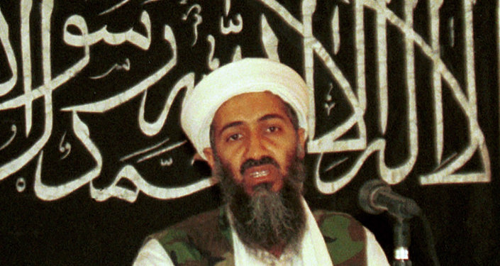 FILE - In this 1998 file photo, Osama bin Laden speaks to a journalist in Khost, Afghanistan