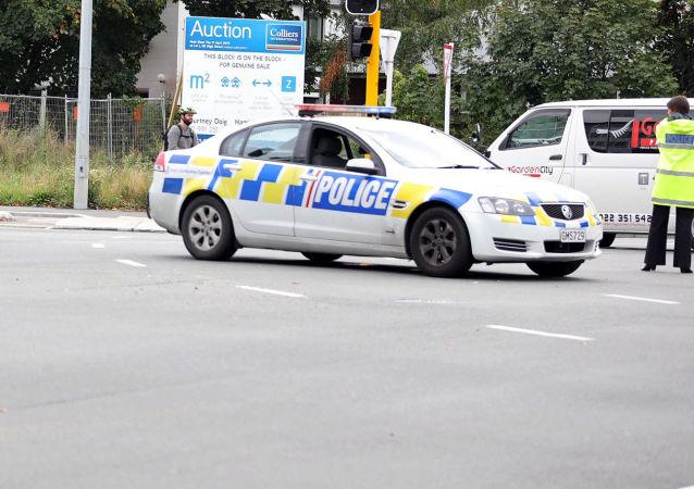 Carros da polícia na área cercada da mesquita Al Noor em Christchurch, Nova Zelândia, 15 de março de 2019
