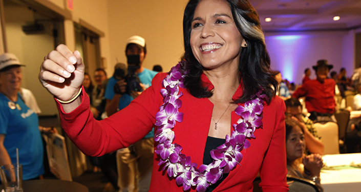 In this Nov. 6, 2018, file photo, Rep. Tulsi Gabbard, D-Hawaii, greets supporters in Honolulu. Gabbard has announced she's running for president in 2020