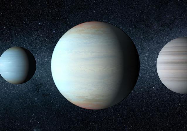 Terceiro planeta, no centro da imagem, a ser descoberto no sistema estelar Kepler-47