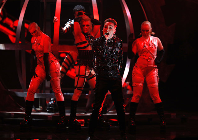 Hatari of A banda islandesa Hatari canta Hatrio mun sigra (O Ódio Prevalecerá) durante a 64ª edição do Festival Eurovisão da Canção em Tel Aviv, Israel.perform the song Hatrio mun sigra during the 2019 Eurovision Song Contest grand final in Tel Aviv, Israel, May 18 May, 2019
