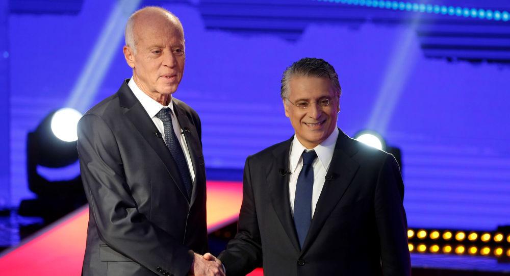 Kais Saied (esquerda) e Nabil Karoui (direita), presidenciáveis da Tunísia. Saied será o próximo presidente, indica pesquisa de boca de urna e contagem parcial dos votos.