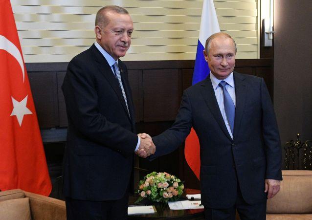 Presidente da Rússia, Vladimir Putin, e da Turquia, Recep Tayyip Erdogan em 22 de outubro de 2019