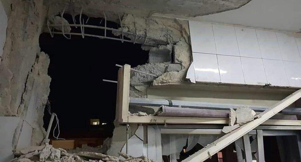 Foto publicada pela agência de notícias síria SANA mostra edifício danificado por ataque aéreo israelense, em Damasco, na Síria, em 20 de novembro de 2019