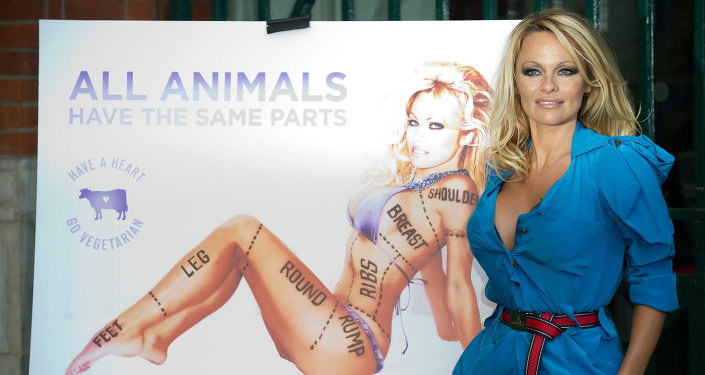 US model and actress Pamela Anderson poses during the unveiling of a new People for the Ethical Treatment of Animals (PETA) poster in Covent Garden, central London on October 24, 2010