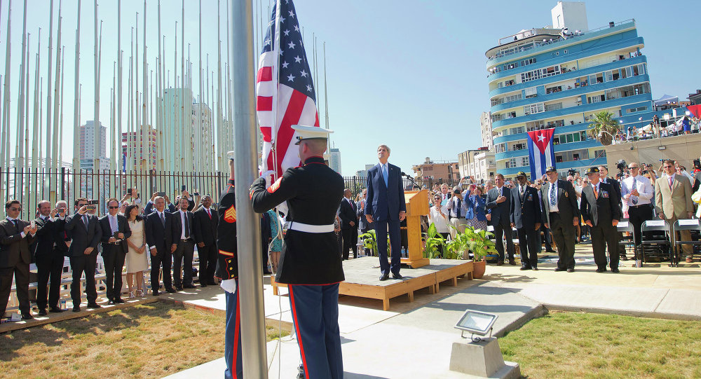Secretary of State John Kerry, and other dignitaries watch as U.S. Marines raise the U.S. flag over the newly reopened embassy in Havana, Cuba. Friday, Aug. 14, 2015.