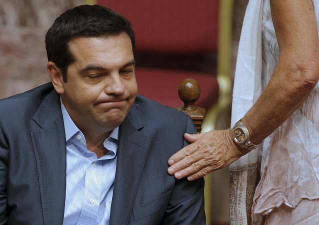 Greek Prime Minister Alexis Tsipras reacts as he attends a parliamentary session in Athens, Greece, August 14, 2015