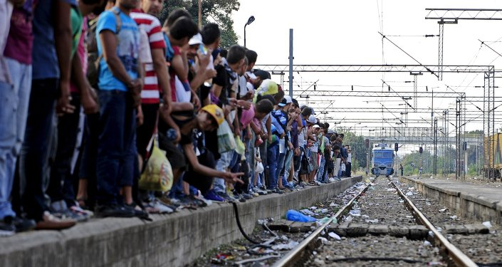Imigrantes na fronteira entre Macedônia e Grécia