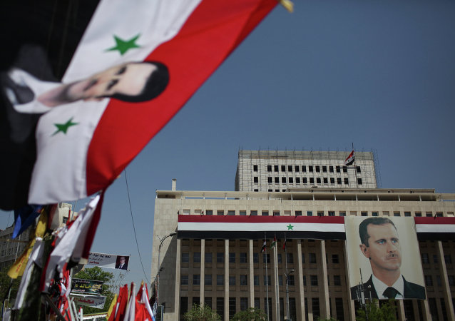 Retrato do presidente sírio Bashar al-Assad no Banco da Síria, em Damasco