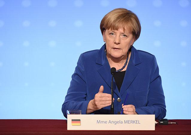 Angela Merkel, chanceler da Alemanha, em entrevista coletiva no palácio Eliseu, em Paris, em 2 de outubro de 2015