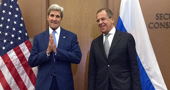 U.S. Secretary of State John Kerry poses with Russian Foreign Minister Sergey Lavrov at the United Nations headquarters in Manhattan, New York September 30, 2015.