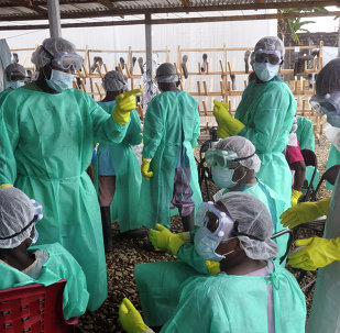 Health care workers inside a USAID-funded Ebola clinic with their Ebola virus protective gear in Liberia