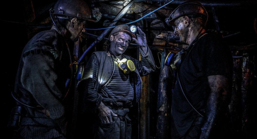 Miners inside the Glubokaya mine, Shakhtyorsk
