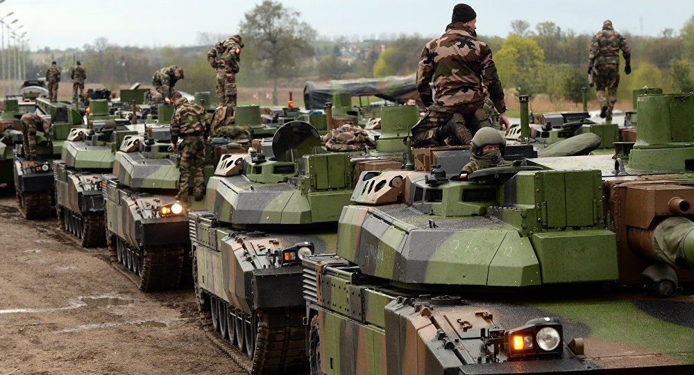 Quantos grupos táticos da OTAN estão instalados perto da Rússia?