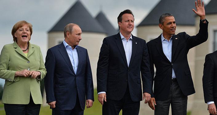 Líderes do G8: a chanceler alemã Angela Merkel, presidente russo Vladimir Putin, primeiro-ministro britânico David Cameron e presdiente norte-americano Barack Obama depois da cúpula do grupo em Lough Erne, Irlanda do Norte, 18 de junho de 2014