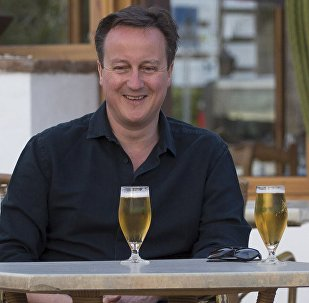Britain's Prime Minister David Cameron poses for a photograph during a family holiday in Playa Blanca, Lanzarote March 25, 2016