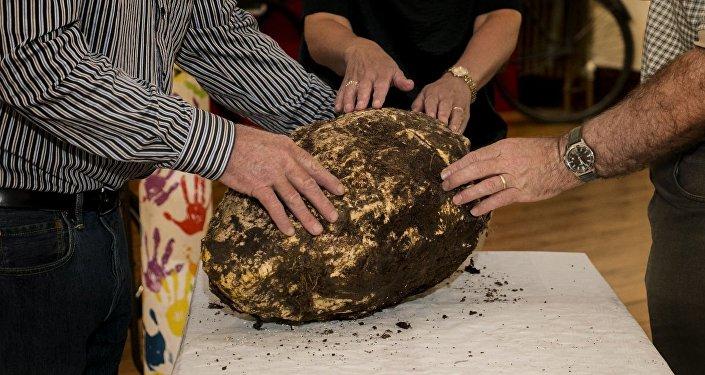 Um pedaço de manteiga de 10 kg, que provavelmente já terá dois mil anos