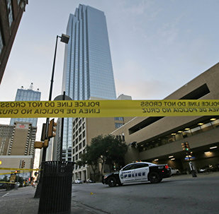 Police tape marks off the area where a shooting took place in downtown Dallas, Friday, July 8, 2016.
