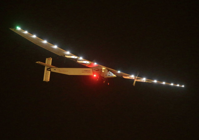 Solar Impulse 2 is seen prior landing at the Nanjing Lukou International Airport in Nanjing, east China's Jiangsu province, on April 21, 2015