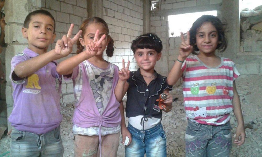 Crianças das cidades cercadas de Al Fuah e Kafarya