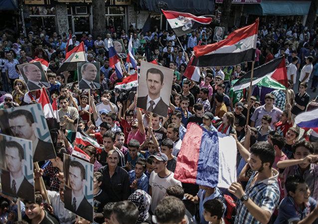 Protesto de apoio ao presidente sírio Bashar Assad