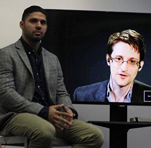 David Miranda divulgando Tratado Internacional sobre direito à privacidade em conferência com Edward Snowden