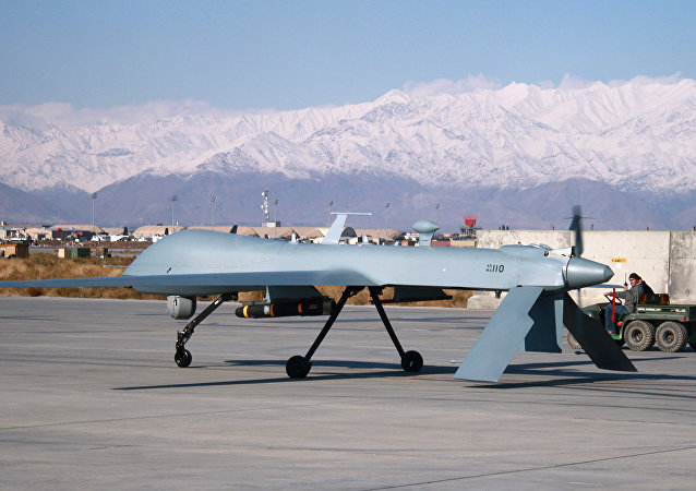 US Predator unmanned drone armed with a missile setting off from its hangar at Bagram air base in Afghanistan, November 27, 2009.